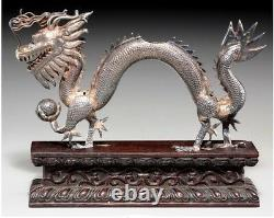 A056 Chinese Export Silver Dragon on Carved Wood Base, late 19th century