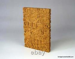 Antique Chinese card holder with intricate sandalwood carvings from late 19th